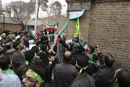 Iranian demonstrators tear down a street sign named ''Rome'', during a demonstration outside the Italian embassy in Tehran February 9, 2010. REUTERS/Fars News/Meghdad Madadi