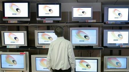 A shopper looks at televisions showing a logo for the BBC News in a retail outlet in central London March 2, 2005. REUTERS/Toby Melville