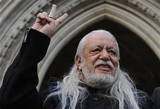 <p>Davender Ghai gestures outside of Britain's High Court, January 18, 2010. REUTERS/Toby Melville</p>