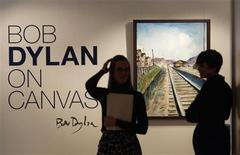 "<p>Employees stand near Bob Dylan's acrylic on canvas painting entitled ""Train Tracks 2"" during the Bob Dylan On Canvas exhibit at the Halcyon Gallery in London, February 10, 2010. REUTERS/Suzanne Plunkett</p>"