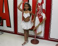 <p>Julia Lira, 7, drum queen of the Viradouro samba school poses during a news conference in Rio de Janeiro, February 10, 2010. Viradouro is one of the 12 samba schools that will parade along Rio's Sambadrome during festivities from February 12-16. REUTERS/Luiza Barros</p>
