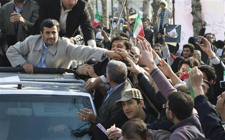 Iranian President Mahmoud Ahmadinejad shakes hands with people as he takes part in the demonstration to mark the 31st anniversary of the Islamic Revolution in Tehran February 11, 2010. REUTERS/Raheb Homavandi