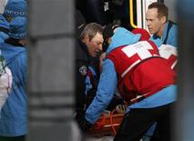<p>Emergency workers load Nodar Kumaritashvili of Georgia into an ambulance after a crash during luge training ahead of the Vancouver 2010 Winter Olympics in Whistler, British Columbia, February 12, 2010. REUTERS/Tony Gentile</p>
