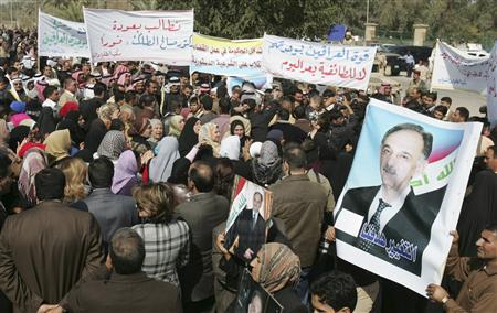 Demonstrators take part in a rally demanding that Iraqi Sunni lawmakers Saleh al-Mutlaq and Dhafer al-Ani be allowed to run in the March 7 parliamentarian election, in Baghdad, February 13, 2010. REUTERS/Saad Shalash