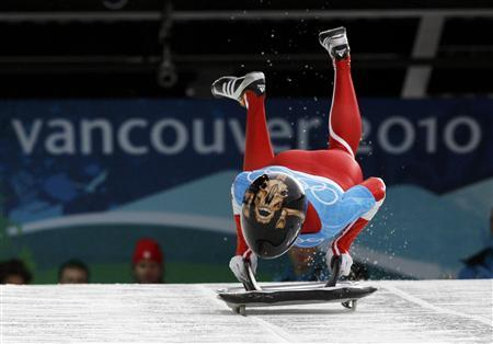 Canada's Melissa Hollingsworth starts a training run for the women's skeleton event at the Vancouver 2010 Winter Olympics in Whistler, British Columbia, February 15, 2010. REUTERS/Tony Gentile