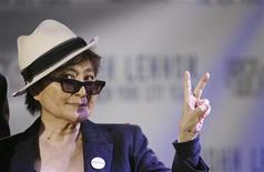 "<p>Yoko Ono gestures as she unveils the ""John Lennon: The New York City Years"" exhibit at the Rock & Roll Hall of Fame Annex in New York May 11, 2009. REUTERS/Lucas Jackson</p>"