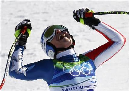 Lindsey Vonn of the U.S. celebrates at the finish line during the women's Alpine Skiing Downhill race at the Vancouver 2010 Winter Olympics in Whistler, British Columbia, February 17, 2010. REUTERS/Kai Pfaffenbach