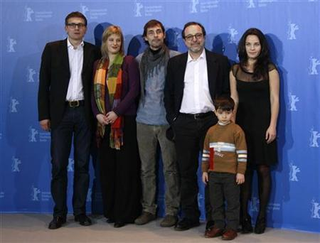 (L-R) Producer Johannes Rexin and Bettina Brokemper, actor Erdal Besikcioglu, director Hasan Semih Kaplanoglu, actor Bora Altas and actress Tuelin Oezen pose during a photocall to promote the movie ''Bal'' (Honey) at the Berlinale International Film Festival in Berlin February 16, 2010. REUTERS/Christian Charisius