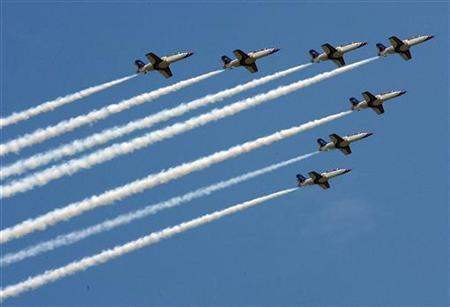 A formation of military AT-3 fighter jets perform during an airforce demonstration at Songshan airport in Taipei September 2, 2007. REUTERS/Nicky Loh