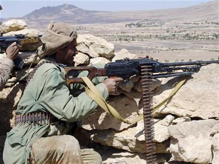 A Yemeni soldier aims his weapon at rebel targets in the northwestern Yemeni province of Saada, where the army is fighting Shi'ite rebels, in this undated picture released by the Yemeni army on January 25, 2010. REUTERS/Yemen Army/Handout
