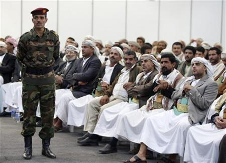An army officer stands guard during a tribal conference in Sanaa, January 26, 2010. REUTERS/Khaled Abdullah