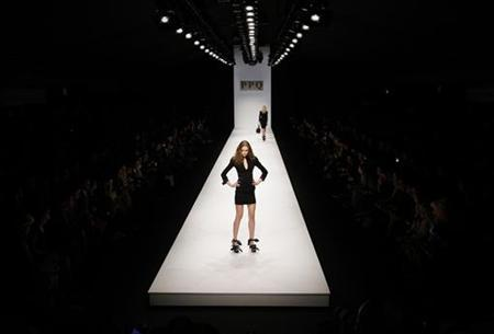 A model presents a creation from the PPQ 2010 Autumn/Winter collection during London Fashion Week, February 20, 2010. REUTERS/Suzanne Plunkett