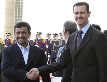 Syria's President Bashar al-Assad (R) welcomes Iran's President Mahmoud Ahmadinejad at al-Shaaeb presidential palace in Damascus February 25, 2010. REUTERS/Khaled al-Hariri