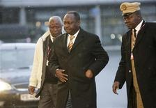 <p>Central African Republic President Francois Bozize (C) arrives at the morning session of United Nations Climate Change Conference 2009 in Copenhagen December 18, 2009. REUTERS/Ints Kalnins</p>
