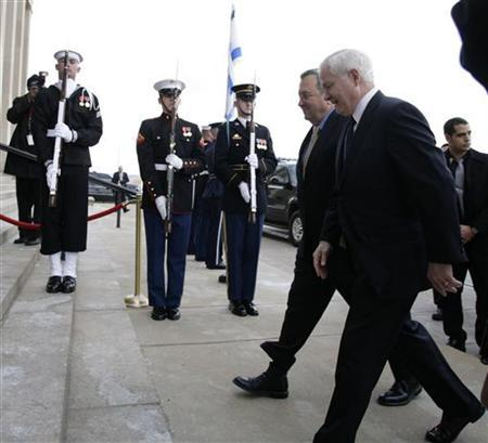 U.S. Secretary of Defense Robert Gates (R) and Israel's Defence Minister Ehud Barak walk past the honour guard before their meeting at the Pentagon in Washington February 25, 2010. REUTERS/Yuri Gripas