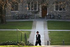 <p>A man walks on the campus of Princeton University in Princeton, New Jersey, November 30, 2009. REUTERS/Steve James</p>
