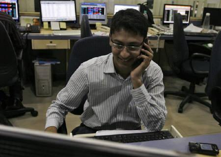 A broker reacts while trading during the presentation of India's federal budget, at a stock brokerage in Mumbai February 26, 2010. REUTERS/Arko Datta