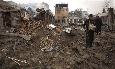 An Afghan policeman stands at the site of a blast in Kabul February 26, 2010. REUTERS/Ahmad Masood