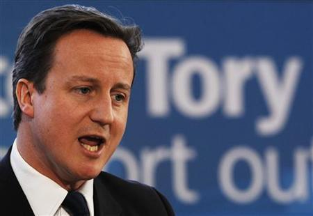 Britain's leader of the Conservative Party, David Cameron, speaks at the launch of his party's new poster campaign ahead of the general election, London February 15, 2010. REUTERS/Luke MacGregor