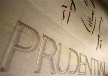 The logo of British life insurer Prudential is seen on their building, in London October 21, 2008. REUTERS/Stephen Hird