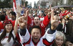 <p>Canadian fans celebrate Canada's victory over the U.S. in the men's ice hockey gold medal game during the Vancouver 2010 Winter Olympics February 28, 2010. REUTERS/Chris Helgren</p>