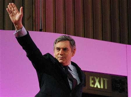 Britain's Prime Minister Gordon Brown waves at his arrival to address the Welsh Labour Conference at Swansea in Wales February 27, 2010. REUTERS/Toby Melville