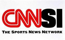 """<p>Логотип телеканала CNN/SI 11 декабря 1996 года. Спонсором команды """"Лотус"""", выступающей в чемпионате мира по автогонкам класса """"Фомула-1"""", будет американский телеканал CNN International, сообщили представители команды во вторник. REUTERS/Ho New</p>"""
