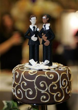A wedding cake figurine of a couple made up of two men is seen at the Gay Wedding show at the Town Hall in Manchester November 6, 2005. REUTERS/Ian Hodgson