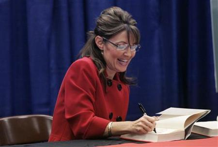 Sarah Palin signs her book 'Going Rogue' during a book signing event at a Barnes and Noble book store in Grand Rapids, Michigan, November 18, 2009. REUTERS/Rebecca Cook