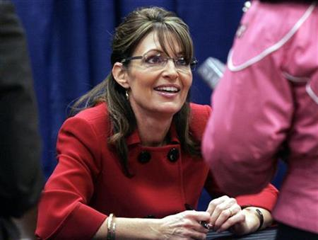 Sarah Palin talks with a supporter during her book signing of her new book 'Going Rogue' at Barnes and Noble bookstore in Grand Rapids, Michigan November 18, 2009 file photo. REUTERS/Rebecca Cook