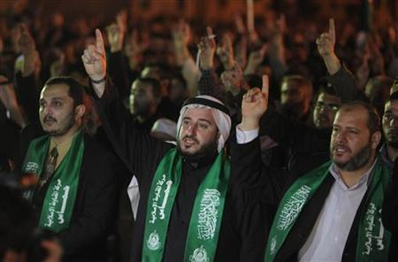 Palestinians attend a Hamas rally against the killing of senior Hamas military commander Mahmoud al-Mabhouh, in northern Gaza Strip, February 17, 2010. REUTERS/Suhaib Salem