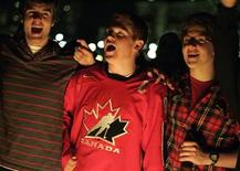 <p>Canadians celebrate by singing the Canadian national anthem at the Eternal Flame in Ottawa February 28, 2010. REUTERS/Chris Roussakis</p>