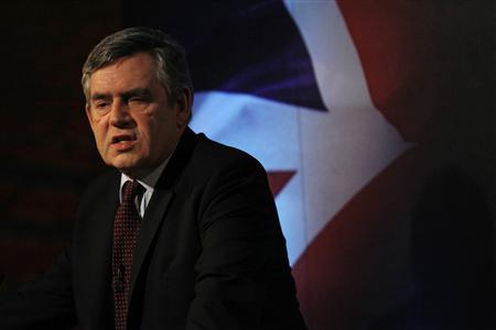 Prime Minister Gordon Brown delivers a speech at Thomson Reuters' offices in east London March 10, 2010. REUTERS/Suzanne Plunkett