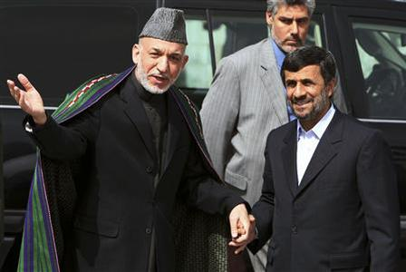 Afghan President Hamid Karzai (L) welcomes his Iranian counterpart Mahmoud Ahmadinejad upon his arrival in Kabul March 10, 2010. REUTERS/Sorkhabi/Pool