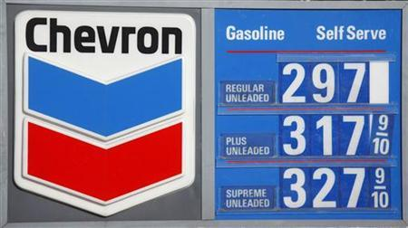 The Chevron corporate logo and the current price of unleaded fuel per gallon are shown at a Washington DC gas station January 11, 2010 file photo. REUTERS/Jason Reed