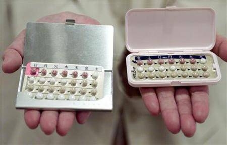 Contraceptive pills are seen at news conference in Tokyo August 26, 1999. REUTERS/Kimimasa Mayama
