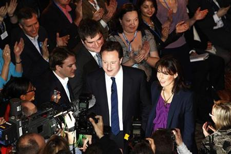 David Cameron, leader of the Conservative Party, and his wife Samantha make their way through the crowd after his keynote speech during the Conservative Party Spring Forum in Brighton, southern England, February 28, 2010. REUTERS/Suzanne Plunkett