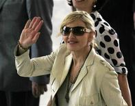 <p>U.S. singer Madonna waves to fans as she arrives at Bandeirantes Palace to meet Sao Paulo's governor Jose Serra February 10, 2010. REUTERS/Paulo Whitaker</p>