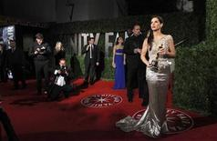 "<p>Sandra Bullock holds her Oscar for best actress in ""The Blind Side"" as she arrives with her husband Jesse James at the 2010 Vanity Fair Oscar party in West Hollywood, California in this March 7, 2010 file photo. REUTERS/Danny Moloshok</p>"
