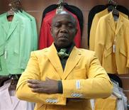 "<p>French-Congolese fashion designer Jocelyn Armel, nicknamed ""Le Bachelor"" poses after an interview with Reuters at his shop in Paris March 18, 2010. REUTERS/Gonzalo Fuentes</p>"