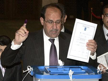 Iraqi's Prime Minister Nuri al-Maliki casts his vote for the Iraqi parliamentary elections at a polling station in the green zone in Baghdad March 7, 2010. REUTERS/Ali Abbas/Pool