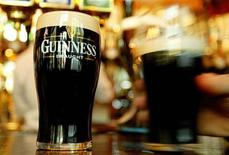<p>Pints of Guinness are seen in a London pub, March 1, 2004. REUTERS/Peter Macdiarmid</p>