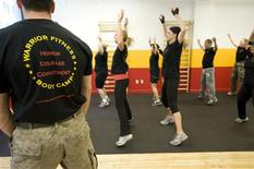 <p>A Boot camp class does jumping jacks at Warrior Fitness Boot Camp in New York City in this 2008 handout photograph released to Reuters March 22, 2010. REUTERS/Warrior Fitness Boot Camp/Handout</p>