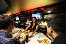 <p>A ticker showing current prices of drinks runs behind the bar of The Exchange Bar & Grill in New York March 24, 2010. REUTERS/Lucas Jackson</p>