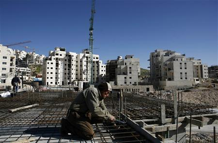A Palestinian labourer works on a construction site at a Jewish settlement near Jerusalem known to Israelis as Har Homa and to Palestinians as Jabal Abu Ghneim March 22, 2010. program.REUTERS/Baz Ratner