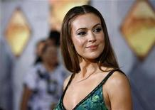 """<p>Actress Alyssa Milano poses at the world premiere of """"Beverly Hills Chihuahua"""" at El Capitan theatre in Hollywood, California September 18, 2008. REUTERS/Mario Anzuoni</p>"""