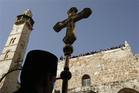 Spectators watch the Greek Orthodox Washing of the Feet ceremony from the roof of the Church of the Holy Sepulchre in Jerusalem's Old City April 1, 2010, ahead of Easter. REUTERS/Ronen Zvulun