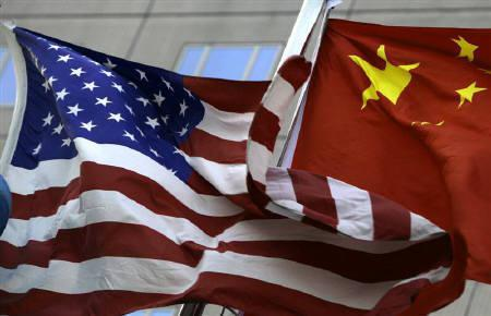 National flags of U.S. and China wave in front of an international hotel in Beijing February 4, 2010. REUTERS/Jason Lee/Files