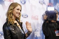 "<p>Performer Didi Benami waves at the party for the 12 finalists of the television show ""American Idol"" in Los Angeles March 11, 2010. REUTERS/Mario Anzuoni</p>"