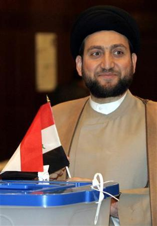 Ammar al-Hakim, the leader of the Supreme Islamic Iraqi Council (ISCI), casts his vote in the Iraqi parliamentary election at a polling station in the Green Zone in Baghdad March 7, 2010. REUTERS/Ali Abbas/Pool
